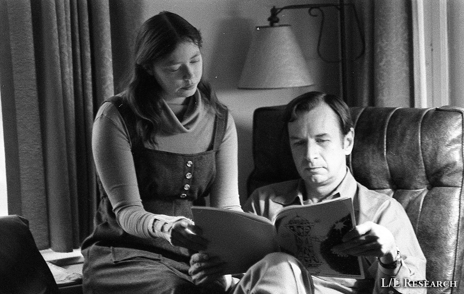 Don and Carla reading a copy of Secrets of the UFO