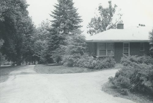 Corner of house with trees in background