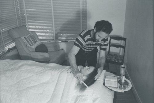 Jim combing Carla's hair